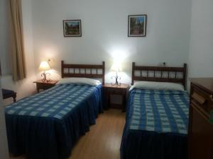 Cama o camas de una habitación en Pensión Ciudad Navarro Ramos