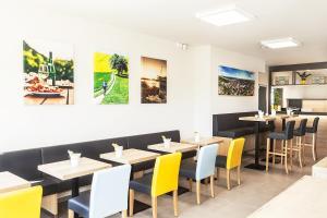 Ein Restaurant oder anderes Speiselokal in der Unterkunft Hotel Tullnerfeld