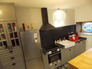 A kitchen or kitchenette at La Vue De Château