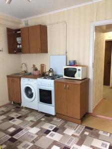 A kitchen or kitchenette at Апартаменты на Чапаева 24