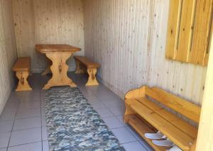 A bed or beds in a room at Usadba u Olgi Holiday Home