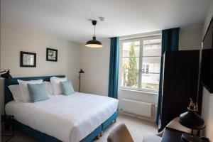 Un ou plusieurs lits dans un hébergement de l'établissement Hôtel Le Chantilly