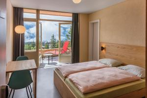 A bed or beds in a room at Crans-Montana Youth Hostel