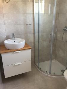 A bathroom at L&L Apartments