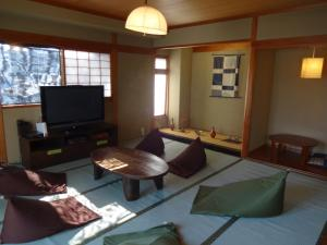A television and/or entertainment center at Khaosan Kyoto Guesthouse