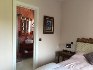 Una cama o camas en una habitación de La Casa en el Camino