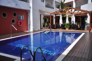 The swimming pool at or near Hotel Puerto Mar