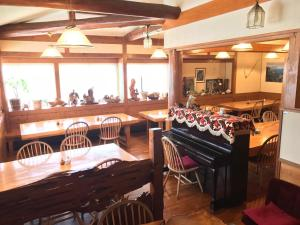 A restaurant or other place to eat at Minshuku Yakushima