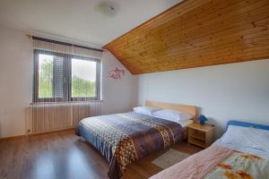 Postel nebo postele na pokoji v ubytování Apartments Božić
