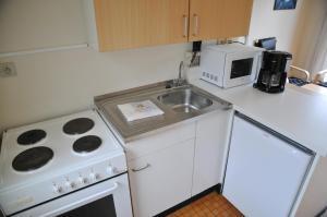 A kitchen or kitchenette at Village de vacances Waulsort
