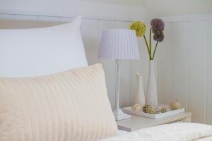 Posteľ alebo postele v izbe v ubytovaní Penzión Kúria