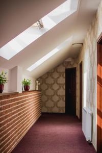 Lobby alebo recepcia v ubytovaní Penzión Kúria