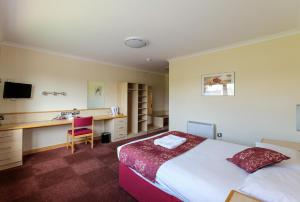 A bed or beds in a room at The Ridgeway House