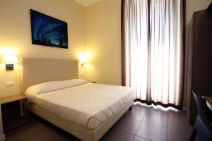 Letto o letti in una camera di Hotel Ferton