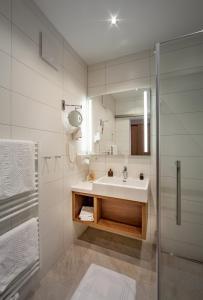 Ein Badezimmer in der Unterkunft Hotel Huberhof