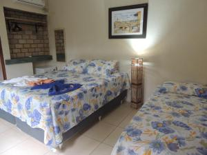 A bed or beds in a room at Canto Verde Pousada