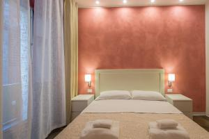Letto o letti in una camera di Vela Rooms