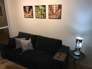 Uma área de estar em Apartamento aconchegante no coração de Santo André