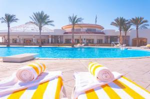The swimming pool at or near Coral Beach Resort Tiran (Ex. Rotana)