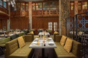 A restaurant or other place to eat at Reichshof Hamburg, Curio Collection by Hilton