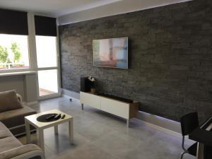 Telewizja i/lub zestaw kina domowego w obiekcie Apartament na Ogrodach