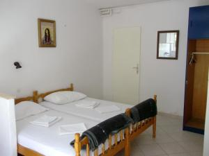 A bed or beds in a room at Soline accommodation