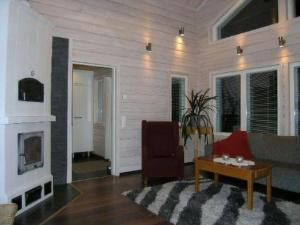 A seating area at Holiday Home Tervaharju