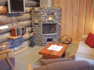 A seating area at Holiday Home Mäentähti a
