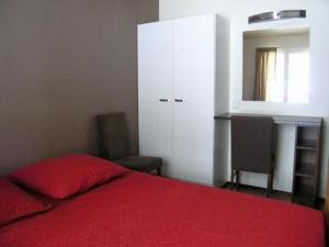 A bed or beds in a room at Holiday Home Toivola 2