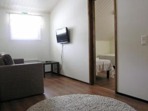 A television and/or entertainment center at Holiday Home Toivola 2