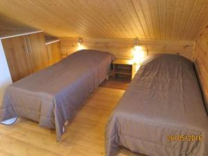 A bed or beds in a room at Holiday Home Tintintupa