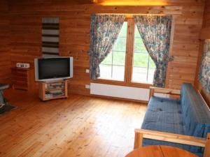 A television and/or entertainment center at Holiday Home Rämeä 2