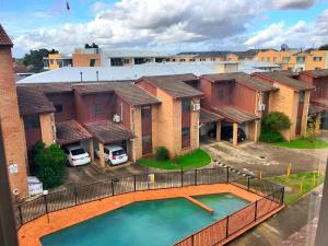A view of the pool at CDB CABRAMATTA 2 BEDROOM 3-5 PEOPLE or nearby