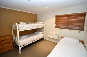 A bunk bed or bunk beds in a room at Mowamba D2