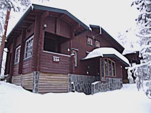 Holiday Home Kelokaltiokylä 39 a during the winter
