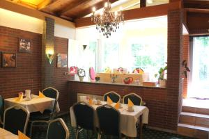 A restaurant or other place to eat at Hotel Palla