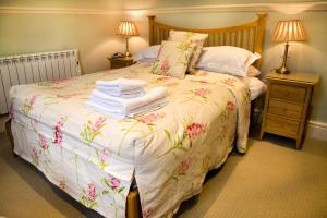 A bed or beds in a room at Monsal Head Hotel