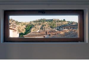 Una televisión o centro de entretenimiento en Apartamentos Rey Moro