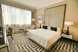 A bed or beds in a room at Al Maha Arjaan by Rotana
