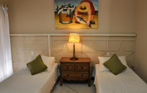 A bed or beds in a room at Pousada Ilha Brazil