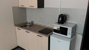 A kitchen or kitchenette at Apartments in Korolev