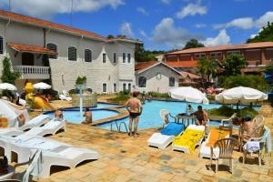 The swimming pool at or near Hotel Fazenda Fonte Colina Verde