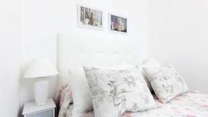 Cama o camas de una habitación en Monteleón Apartment