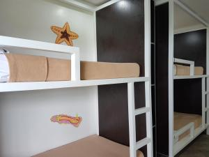 A bunk bed or bunk beds in a room at 1521 Hostel