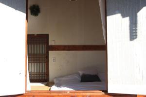 Un ou plusieurs lits dans un hébergement de l'établissement Ginkgo Tree Guesthouse