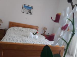 Ένα ή περισσότερα κρεβάτια σε δωμάτιο στο Πανσιόν Πωσειδωνία