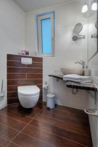 Ein Badezimmer in der Unterkunft Hotel am Schwanenweiher
