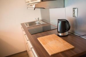 A kitchen or kitchenette at Apartman Luhacovice