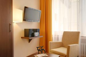 A television and/or entertainment center at Hotel Mercedes City