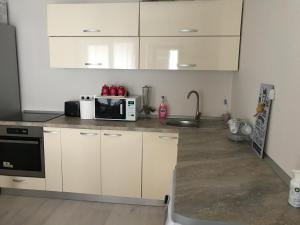 A kitchen or kitchenette at A&F ApartHotel